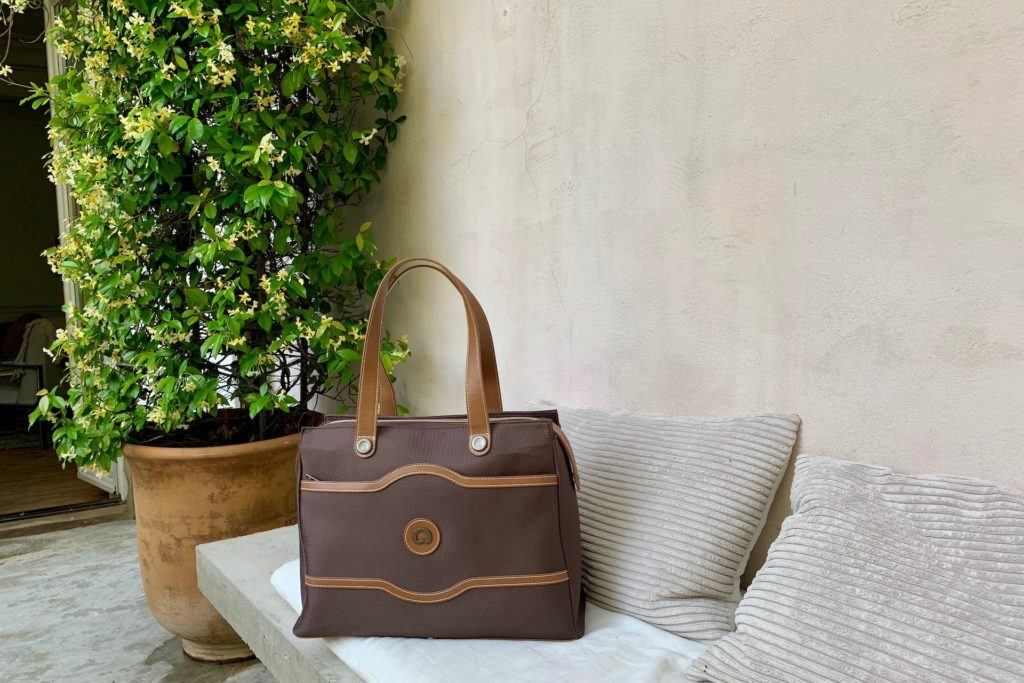 Delsey Paris Soft Air Chatelet bag on a bench