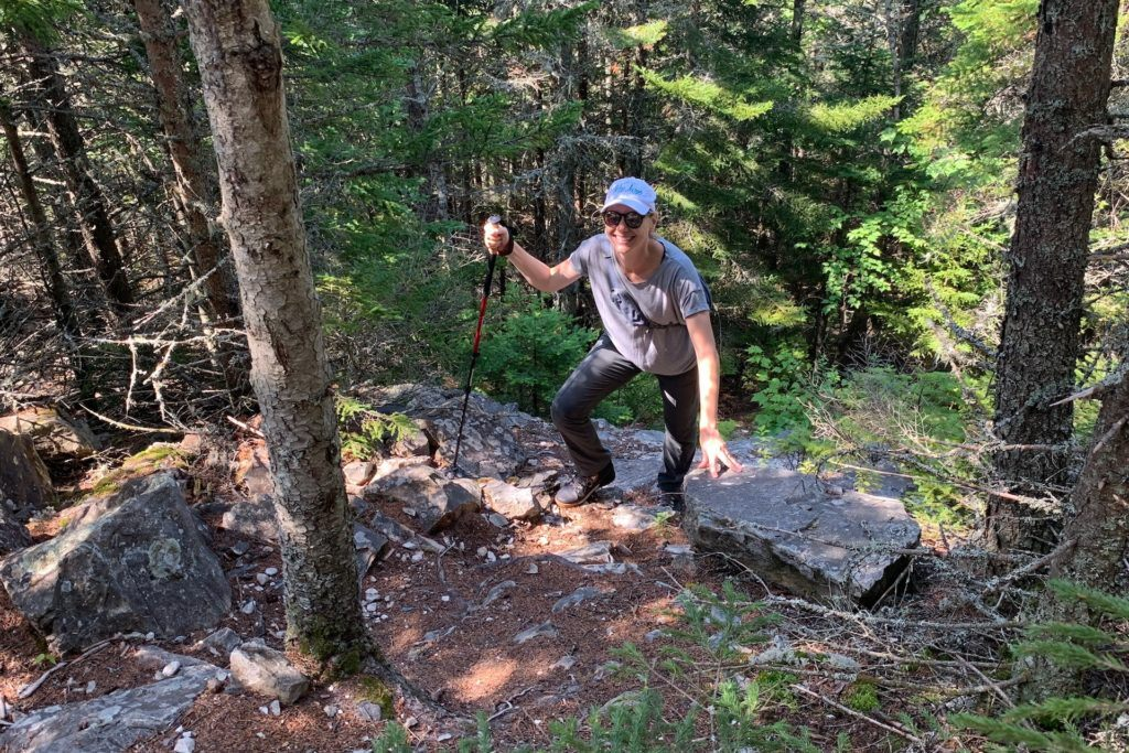 Kim Tate climbing up Little Mount Kineo