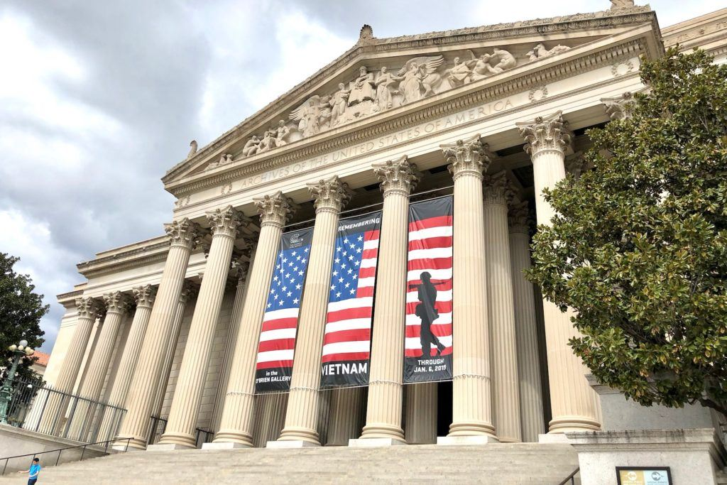 National Archives front with flag
