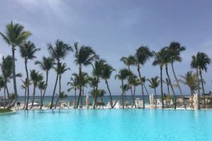 Pool and palm trees at Eden Roc at Cap Cana