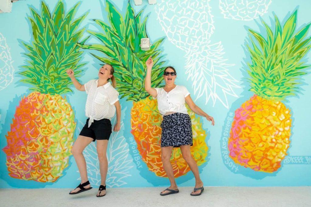 Kim and Tamara in front of pineapple mural