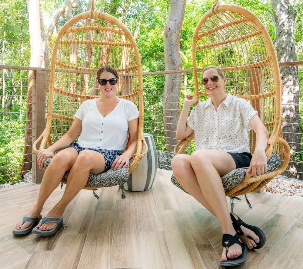 Kim and Tamara on swing chairs