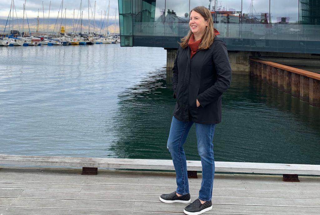 Tamara in Steve Madden black slip ons and Anatomie jacket in front of the Harpa Concert Hall in Reykjavik