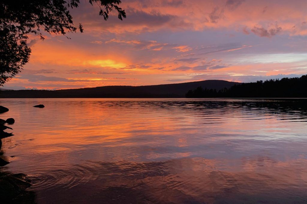 Sunset reflecting on the water of Lower Wilson Pond in Maine
