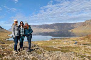 3 friends overlooking fjord near Dynjandi waterfall