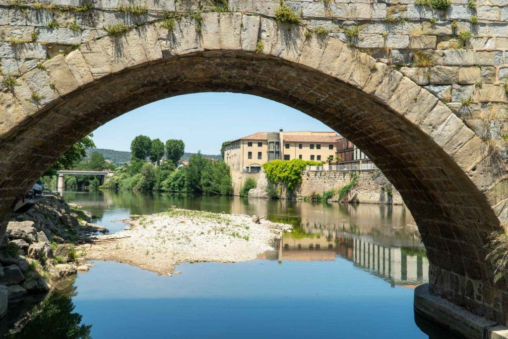Town of Limoux through the arch of a bridge