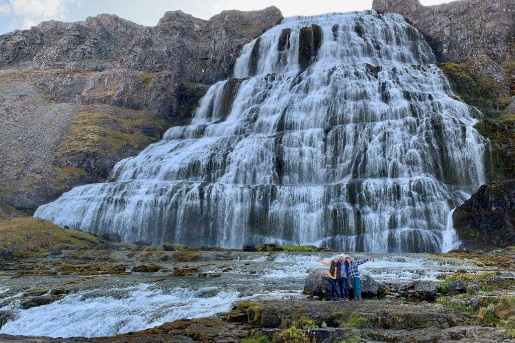 3 women in front of Dynjandi waterfall