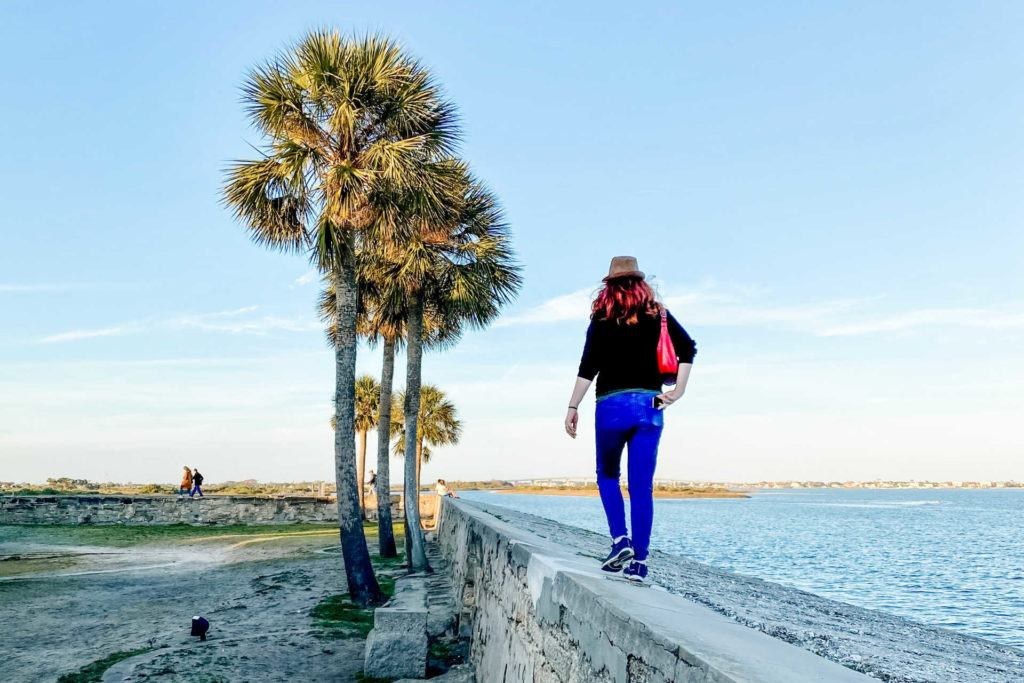 Keryn walking on wall at Castillo de San Marcos