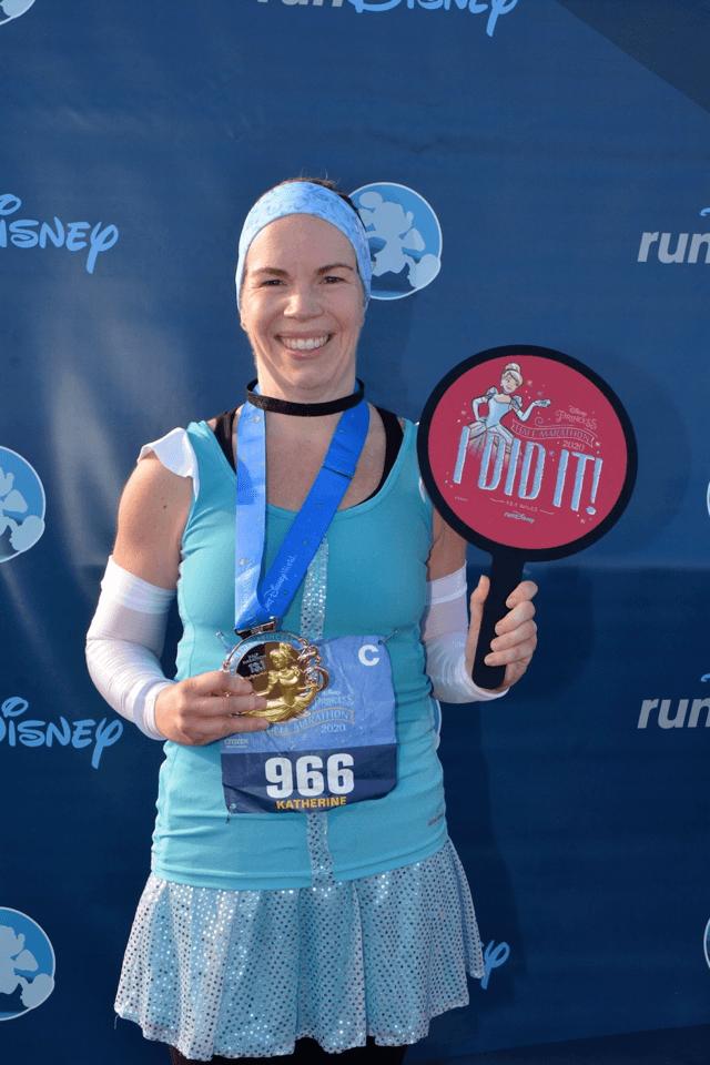 Katherine runner holding I did it sign at the Disney half marathon