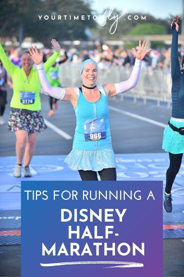 Tips for running a Disney half marathon runner crossing the finish line