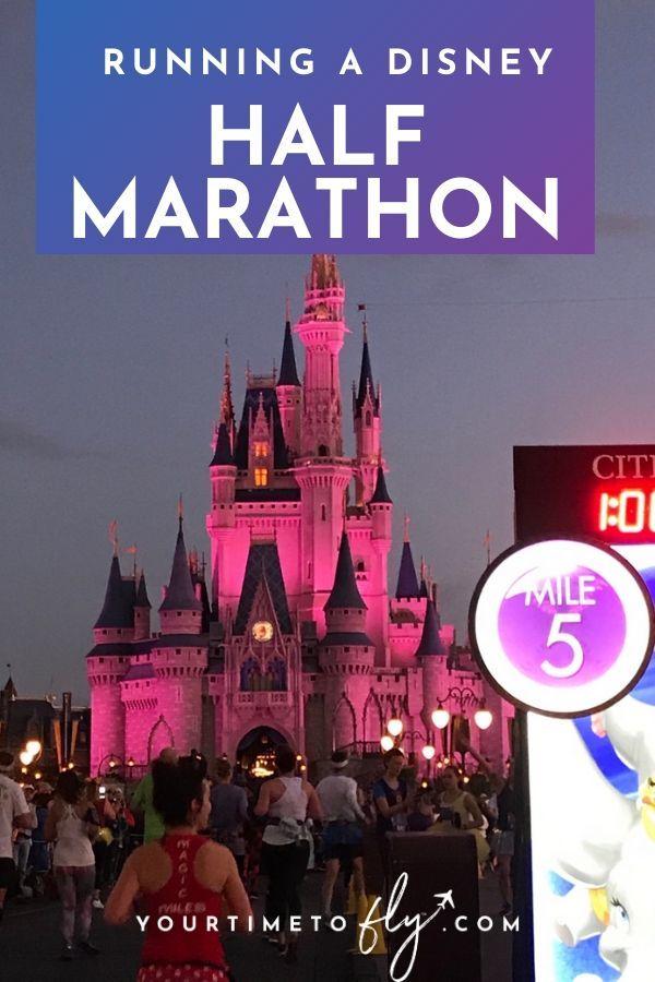 running a disney Princess half marathon with castle in the background