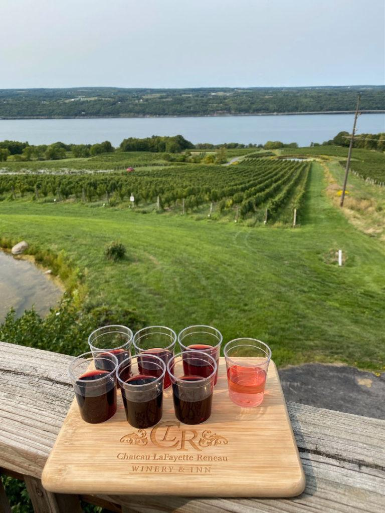Chateau LaFayette Reneau tasting flight on porch with view of the lake