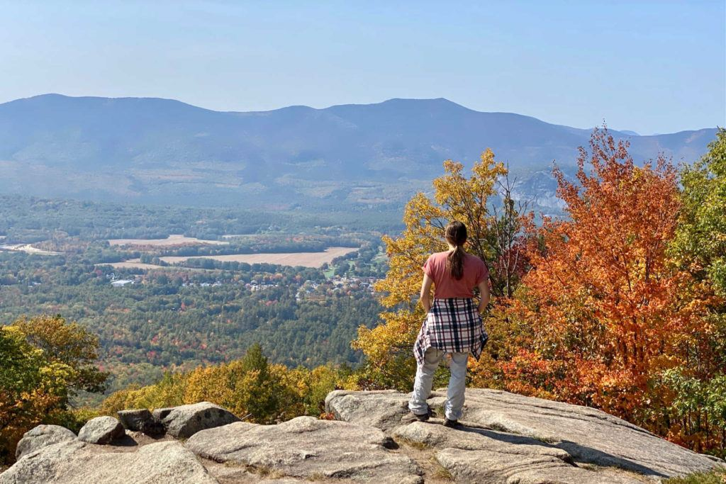 woman hiker overlooking view at Cranmore Mountain