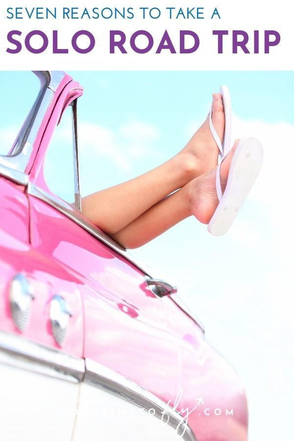 Seven reason to take a solo road trip pink car feet sticking out of convertible