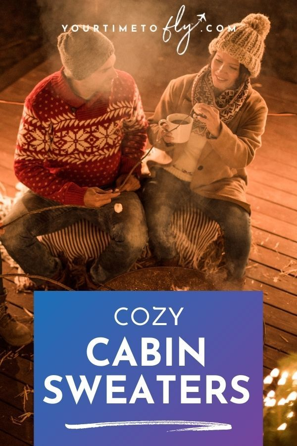 Cozy cabin sweaters with a couple sitting by an outdoor fire