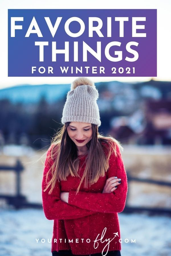 Favorite things for winter 2021 with girl in red sweater and tan hat standing in snow and looking down