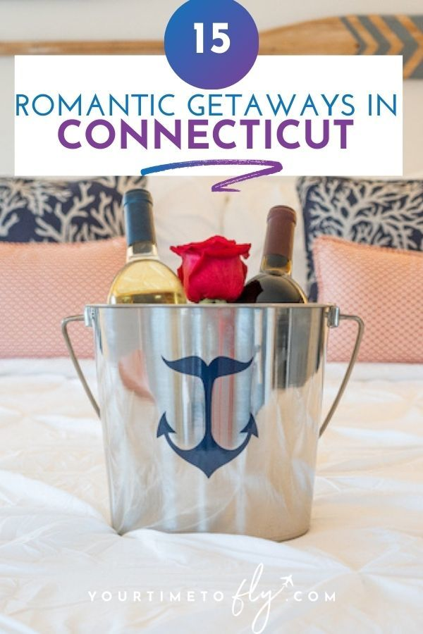 15 romantic getaways in Connecticut with wine and a rose in an ice bucket on the bed