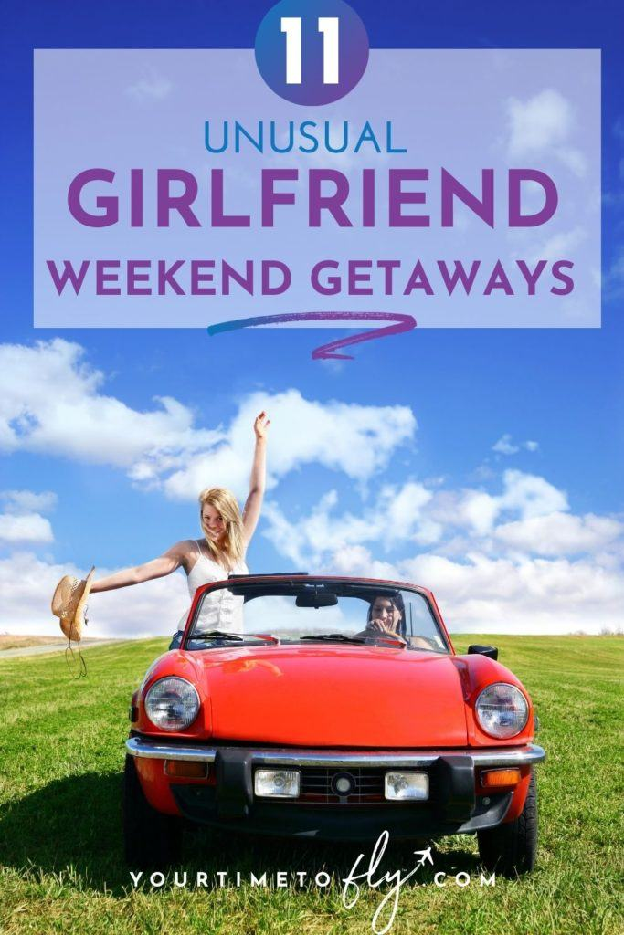 11 unusual girlfriend weekend getaways with a girl standing up in a red convertible car sitting in a field