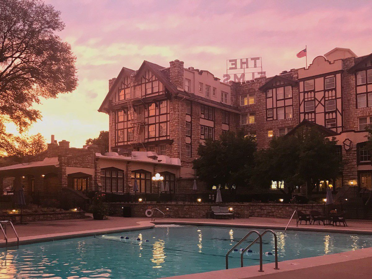 The Elms hotel and pool at sunset