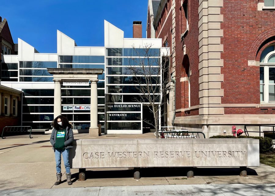 Teen in front of Case Western Reserve University sign