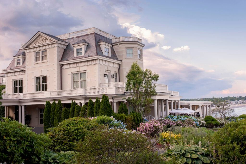 The Chanler at Cliff Walk exterior with flowering bushes out front
