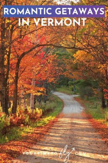 Romantic getaways in Vermont road through the woods with orange fall leaves