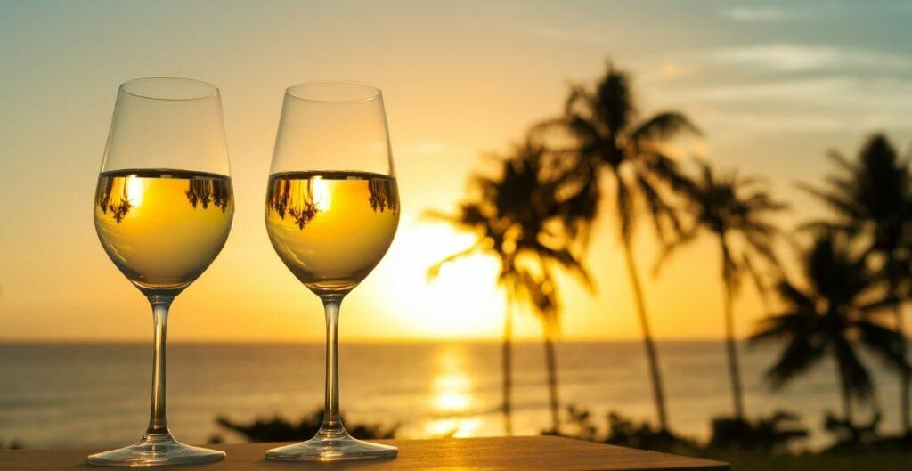 two wine glasses overlooking sunset over water and palm trees with reflection of trees in the wine