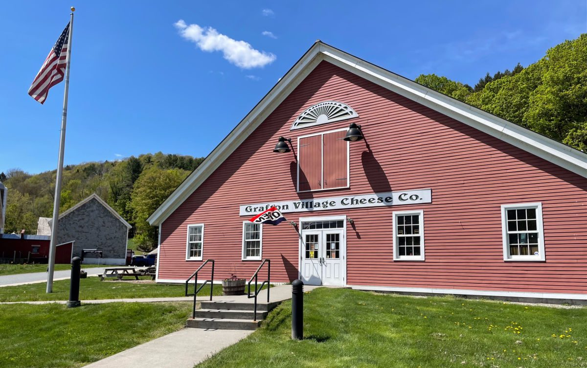 Grafton Village Cheese Company red building with an open flag