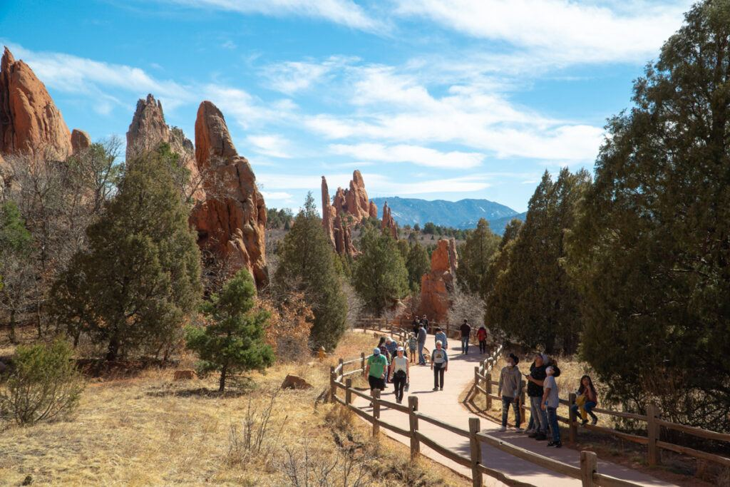 People on a path curving through Garden of the Gods Park