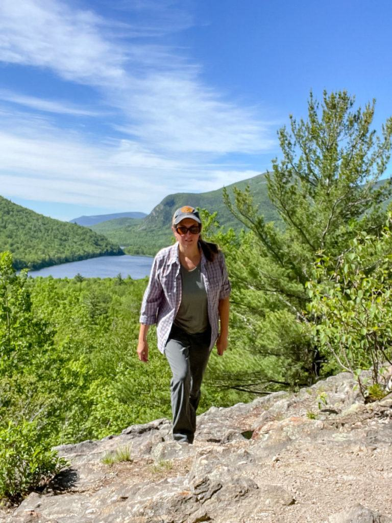 Woman hiking on the ledges trail in Baxter State Park