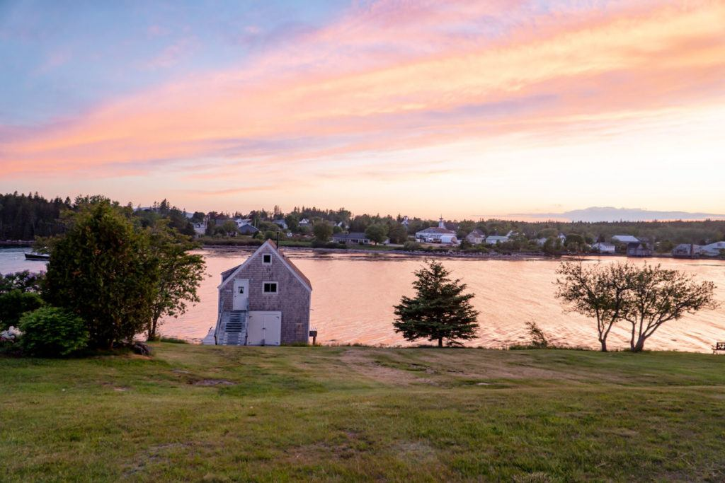 Boat house at Main Stay Cottages and RV Park at sunset