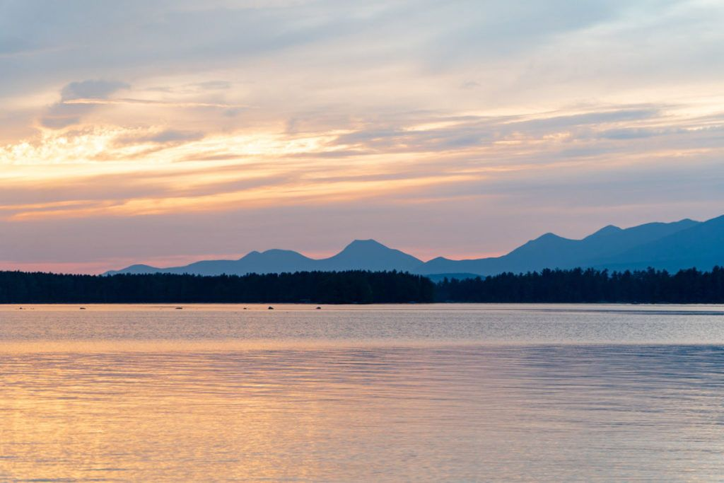 sunset over Millinocket Lake with the mountains in the background