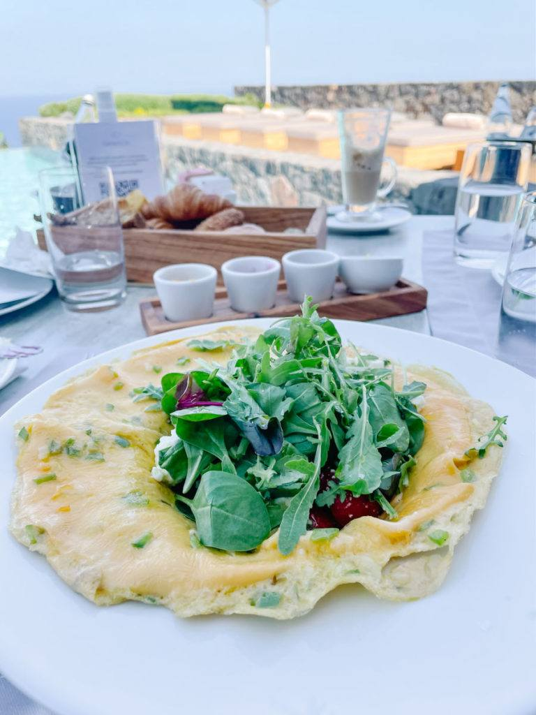 Omelette with salad on it poolside