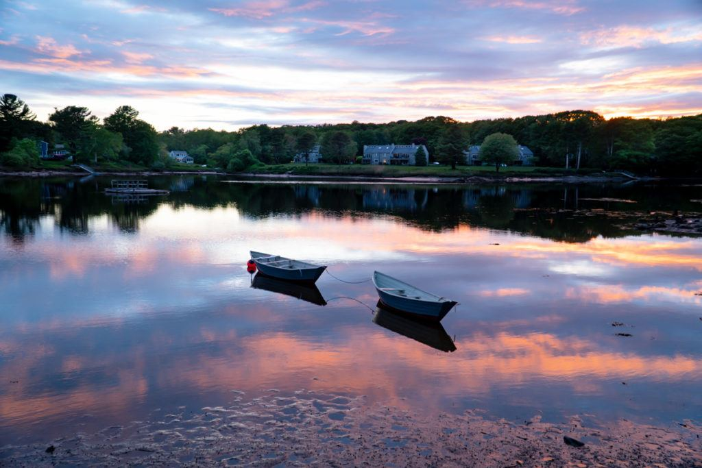 two row boats on the water with sunset reflection in Kennebunkport