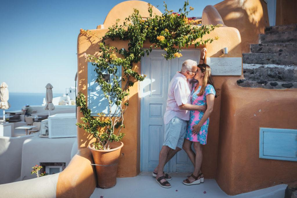Couple kissing in front of house in Santorini