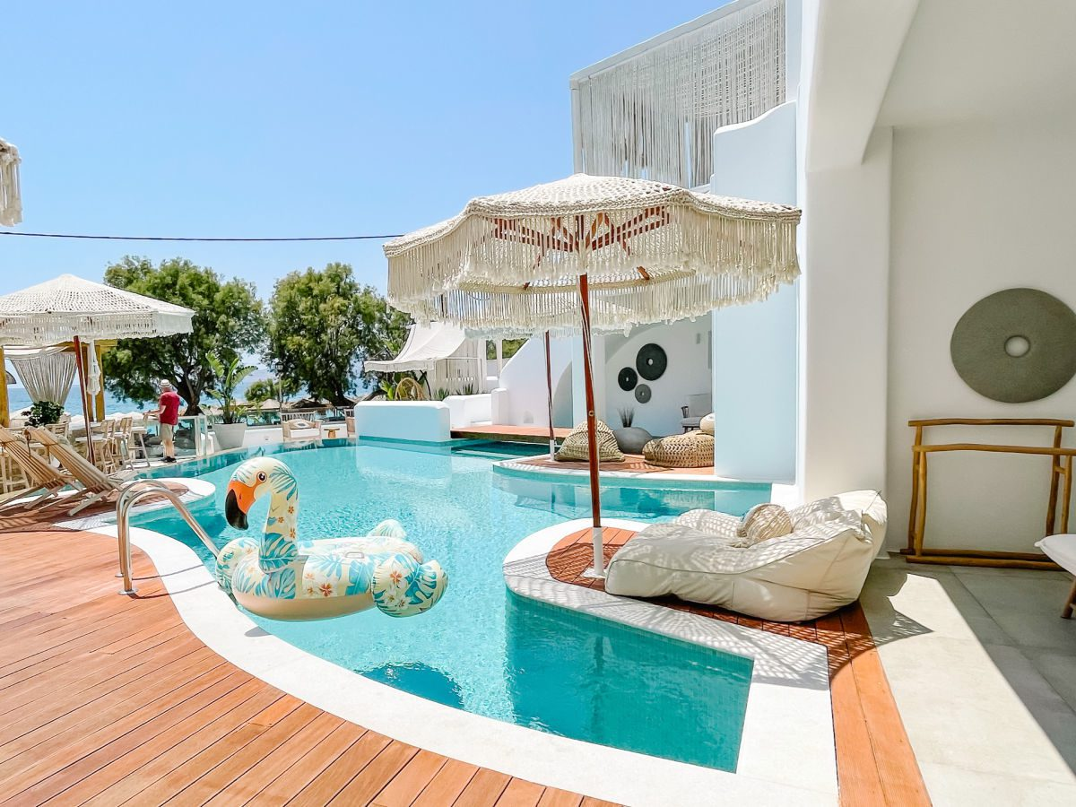 Pool with flamingo float and subbed with umbrella