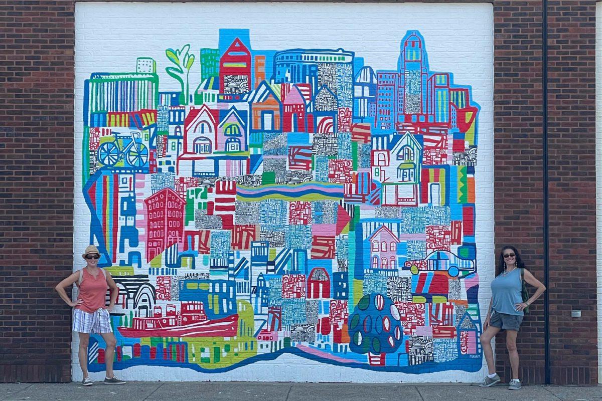 Women in front of a Buffalo mural