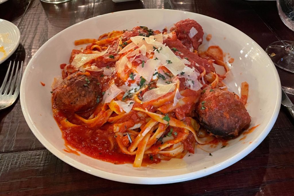 Meatballs and pasta on a white plate