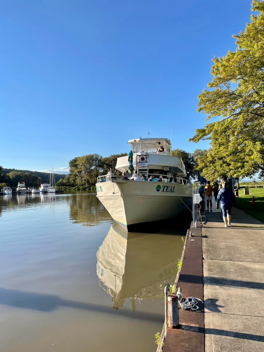 Discover Cayuga Lake boat tours Teal boat at dock in Ithaca
