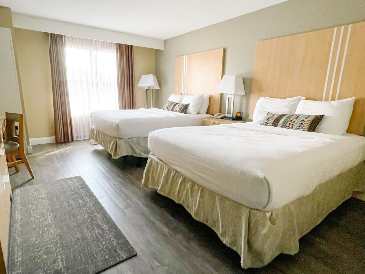 Two queen beds in bedroom at Hotel Ithaca